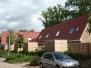 Dak- en gevelrenovatie van 12 geschakelde woningen te Weerselo